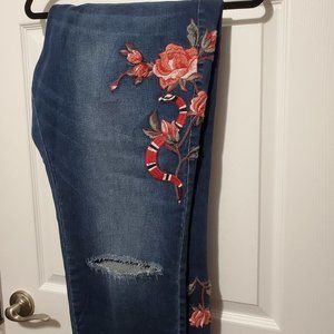 Ladies distressed and embroidered jeans